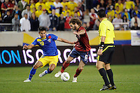 Kyle Beckerman (6) of the United States and Luis Saritama (19) of Ecuador. The men's national team of the United States (USA) was defeated by Ecuador (ECU) 1-0 during an international friendly at Red Bull Arena in Harrison, NJ, on October 11, 2011.