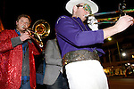 The March Madness Marching Band, a Lexington group, performs during the Mardi Gras celebration at Bourbon and Toulouse in Lexington, Ky., on Tuesday, February 12, 2013. Photo by Genevieve Adams | Staff