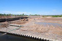 Tempe, Arizona. Construction work in the early stages. The artificial lake is a reservoir on a segment of the currently dry riverbed of the Salt River. The new dam will be a cost-effective solution expected to last for decades. The construction is called Town Lake Western Dam Replacement Project. Photo by Eduardo Barraza © 2014