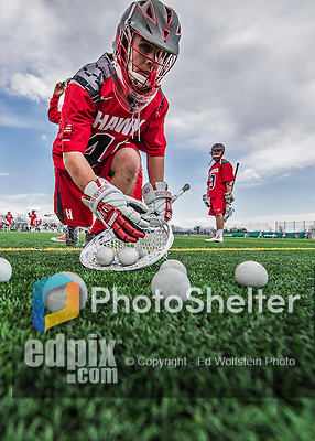 18 April 2015: University of Hartford Hawk Goaltender Evan Quinn, a Sophomore from Niskayuna, NY, gathers up practice balls prior to a game against the University of Vermont Catamounts at Virtue Field in Burlington, Vermont. The Cats defeated the Hawks 14-11 in the final home game of the 2015 season. Mandatory Credit: Ed Wolfstein Photo *** RAW (NEF) Image File Available ***