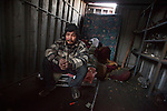 QUEENS, NY -- OCTOBER 25, 2013:  Giovany Sadano sits inside an abandoned shipping container in Willets Point, where he sometimes sleeps, on October 25, 2013 in Queens, NY.  PHOTOGRAPH  BY MICHAEL NAGLE FOR THE NEW YORK TIMES