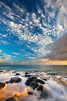 A brilliant array of colors at sunrise at Larsen's Beach, Kilauea, Kauai