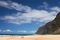 Polihale Beach Park, looking towards the Na Pali Coast, with couple in beach chairs; Kauai, Hawaii.