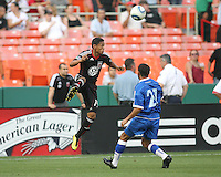 Andy Najar #14 of D.C. United heads over Juan Carlos Moscoso #21  of El Salvador during an international charity match at RFK Stadium, on June 19 2010 in Washington DC. D.C. United won 1-0.