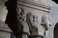 Capital with human heads, atop pairs of 8-sided columns in the colonnade of the Cloister, built in late Romanesque style by Mihoje Brajkov of Bar in 1360, at the Franciscan monastery on Stradun or Placa, Old Town, Dubrovnik, Croatia. The city developed as an important port in the 15th and 16th centuries and has had a multicultural history, allied to the Romans, Ostrogoths, Byzantines, Ancona, Hungary and the Ottomans. In 1979 the city was listed as a UNESCO World Heritage Site. Picture by Manuel Cohen