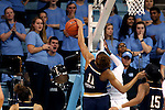 22 January 2017: Notre Dame's Brianna Turner (11) blocks a shot by North Carolina's Destinee Walker (behind). The University of North Carolina Tar Heels hosted the University of Notre Dame Fighting Irish at Carmichael Arena in Chapel Hill, North Carolina in a 2016-17 NCAA Division I Women's Basketball game. Notre Dame won the game 77-55