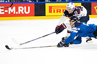 American Clayton Keller (back) and Finland's Miro Aaltonen reach out for the puck during the Ice Hockey World Championship quarter-final match between the US and Final in the Lanxess Arena in Cologne, Germany, 18 May 2017. Photo: Marius Becker/dpa /MediaPunch ***FOR USA ONLY***