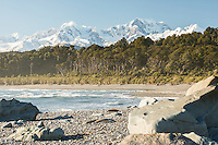 Wild and remote Gillespies Beach with Southern Alps, Mount Cook and Mount Tasman in background, Westland Tai Poutini National Park, UNESCO World Heritage Area, West Coast, New Zealand, NZ