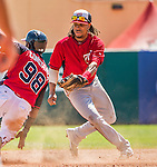 21 March 2015: Washington infielder Emmanuel Burriss is unable to tag a base-stealing Jose Constanza in the 7th inning of a Spring Training Split Squad game against the Atlanta Braves at Champion Stadium at the ESPN Wide World of Sports Complex in Kissimmee, Florida. The Braves defeated the Nationals 5-2 in Grapefruit League play. Mandatory Credit: Ed Wolfstein Photo *** RAW (NEF) Image File Available ***