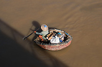 A Basket Boat or also called a Round Boat viewed from the Tran Hung Dao Bridge in Phan Thiet City, Binh Thuan Province, Vietnam