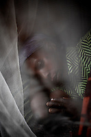 40 year-old Wimana Nyirarukundo rests at SOPROP (Solidarite Pour la Promotion Sociale et la Paix), a partner of MSF, in Kichanga, North Kivu, DRC, on Tuesday, Feb. 19, 2008. .Wimana was raped and beaten by a CNDP soldier on 13/2/08. Her husband has since left her..***Names are for record purposes only and should not be published***.Sexual violence has become systematic in DRC with the brutality of attacks often leaving the victims with severe damage to reproductive organs, resulting in multiple fistulas and incontinence. According to the UN Population Fund an average of 1,100 rape cases are reported each month...