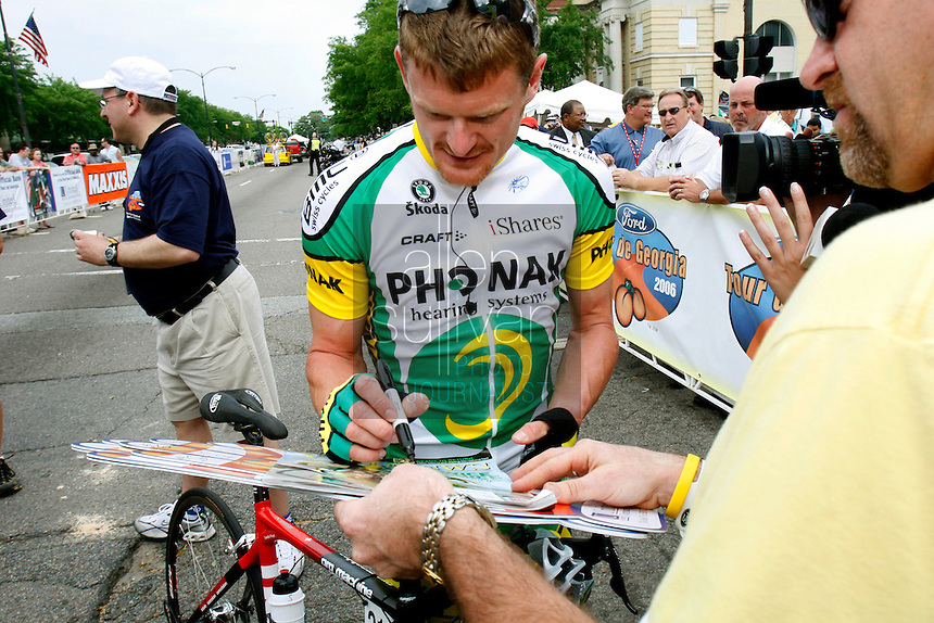 Floyd Landis of Phonak Hearing Systems signs a poster for a fan before the start of Stage 1 of the 2006 Ford Tour de Georgia pro cycling race on Tuesday, April 18, 2006 in Augusta, Ga. Lars Michaelsen of Team CSC won the 129-mile stage from Augusta to Macon in 4:45:46.<br />