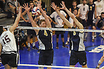 27 APR 2014: Alex McColgin (4) andPaul Kuhn (9) block against Springfield College during the Division III Men's Volleyball Championship held at the Kennedy Sports Center in Huntingdon, PA. Springfield defeated Juniata 3-0 to win the national title.  Mark Selders/NCAA Photos