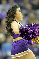 DEC 22, 2015:  Washington cheerleader Miki Saito entertained fans during a TV timeout in the game against Seattle University. Washington defeated Seattle University 79-68 at Alaska Airlines Arena in Seattle, WA.