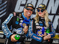 Sep 18, 2016; Concord, NC, USA; NHRA funny car driver John Force (left) and daughter Courtney Force during the Carolina Nationals at zMax Dragway. Mandatory Credit: Mark J. Rebilas-USA TODAY Sports
