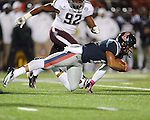 Ole Miss quarterback Barry Brunetti (11) dives vs. Texas A&amp;M defensive lineman Jonathan Mathis (92) in Oxford, Miss. on Saturday, October 6, 2012. Texas A&amp;M won 30-27...