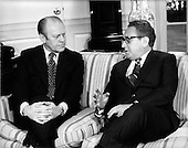United States Secretary of State Henry A. Kissinger, right, meets United States President Gerald R. Ford, left, in the Oval Office at the White House in Washington, D.C. on February 19, 1975 to report on his 10 day trip to Egypt and Israel.  Kissinger later told reporters that Syria was in the way of peace in the middle east.  He was firm in his belief there would someday be peace in the region.<br /> Credit: Benjamin E. &quot;Gene&quot; Forte - CNP