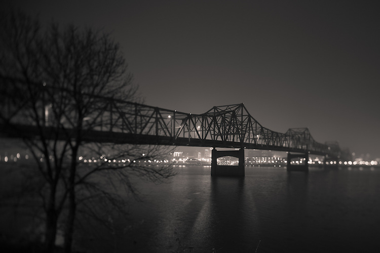 Shrouded in cold winter fog, the Murray Baker bridge rises over the Illinois River in Peoria, IL.