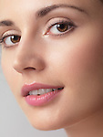 Closeup beauty portrait of a young woman face with clean natural look and smooth skin