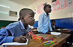 Refugee boys in class in a school operated by St. Andrew's Refugee Services in Cairo, Egypt. Located at St. Andrews United Church of Cairo, the program is supported by Church World Service.