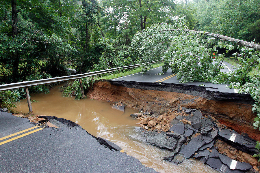 A road washes away after a flooding rain storm in Albemarle County, VA. Photo/Andrew Shurtleff