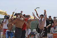Huntington Beach, CA - 5/5/07:   Matt Prosser is congratulated by fans who call themselves Prosser's Pirates after Mayer / Prosser's  29-27, 21-16 victory over Jensen / Placek Saturday during the 2007 AVP CROCS Tour in Huntington Beach. Prosser's Pirates are Long Beach State volleyball players and Prosser is their assistant coach..Photo by Carlos Delgado