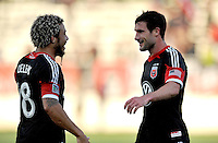 Chris Pontius (13) of D.C. United celebrates with teammate Nick DeLeon his score. D.C. United defeated the The New England Revolution 3-1 in the Quarterfinals of Lamar Hunt U.S. Open Cup, at the Maryland SoccerPlex, Tuesday June 26 , 2013.
