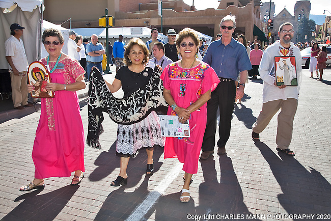 Rosina Lopez de Short and Lupita McDowell are  among the  artists participating in the Sunday Procession on the plaza at the 2009 Spanish Market in Santa Fe, New Mexio