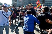 Roma 25 Aprile 2014<br /> Tensioni fra comunit&agrave; Ebraica di Roma  e attivisti pro Palestina al corteo per la Liberazione dal Nazifascismo dell'Anpi. Nella foto: Agenti di polizia in borghese (di spalle) cercano di bloccare i manifestanti della comunit&agrave; ebraica <br /> Rome April 25, 2014 <br /> Tensions between the Jewish community of Rome and pro-Palestinian activists during the  march for the Liberation of Nazi-fascism by the National Association of Italian Partisans.Pictured: Police officers in plain clothes (from behind) try to block the protesters of the Jewish community.