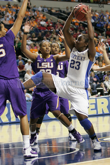 Sophomore forward Samarie Walker grabs a rebound during the SEC Women's Basketball Tournament game UK Hoops vs. LSU at Bridgestone Arena in Nashville, Tenn., on Saturday, Mar. 3, 2012. Photo by Tessa Lighty | Staff