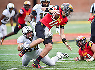 College Park, MD - OCT 1, 2016: Maryland Terrapins quarterback Perry Hills (11) is sacked by Purdue Boilermakers defensive tackle Jake Replogle (54) during game between Maryland and Purdue at Capital One Field at Maryland Stadium in College Park, MD. The Terps got the win 50-7 over visiting Purdue. (Photo by Phil Peters/Media Images International)