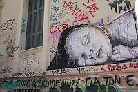 Atene, murale raffigurante un bambino che dorme