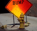 Reflective construction sign warns of a large bump in the road.