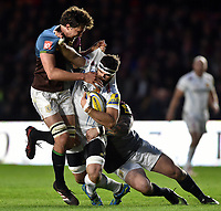 Don Armand of Exeter Chiefs is double-tackled by Charlie Matthews and Joe Marler of Harlequins. Aviva Premiership match, between Harlequins and Exeter Chiefs on April 14, 2017 at the Twickenham Stoop in London, England. Photo by: Patrick Khachfe / JMP