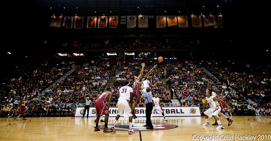 TALLAHASSEE, FL 2/14/10-FSU-BC BB10 CH02-Florida State's Solomon Alabi, right, gets the tip off away from Boston College's Josh Southern during second half action Sunday at the Donald L. Tucker Center in Tallahassee. The Seminoles beat the Eagles 62-47. The Seminoles beat the Eagles 62-47...COLIN HACKLEY PHOTO