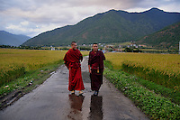 Buddhist lamas on a road in Paro. Arindam Mukherjee..