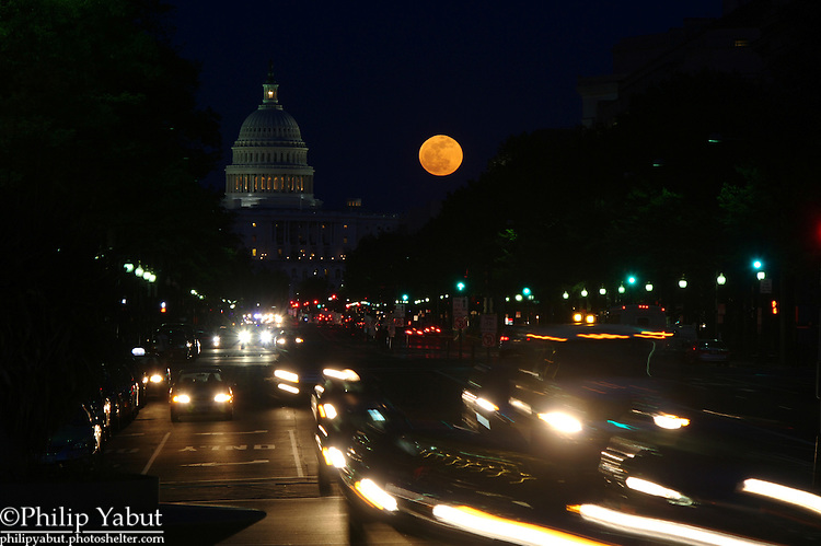 April 25, 2013, moonrise behind the U.S. Capitol.