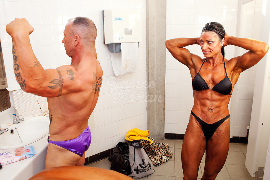 23/10/2010. Irish female physique and figure fitness national championships.  Sophia Mc Namara (1st place winner) from Limerick is pictured backstage in the womens toilets with her boyfriends father Jimmi Cassidy during the female physique category as part of the RIBBF national bodybuilding championships at the University of Limerick Concert Hall, Limerick, Ireland. Picture James Horan.