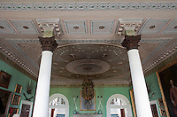Corinthian columns support the ornate plasterwork ceiling featuring sprouting shamrocks and Roman shields