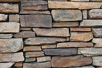 Natural Stacked Stone Wall Design