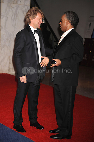 Jon Bon Jovi and Reverend Al Sharpton arrive at the White House Correspondents' Association Dinner in Washington, DC. May 1, 2010. Credit: Dennis Van Tine/MediaPunch