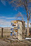An outhouse covered with license plates created by by Chief Rolling Mountain Thunder (aka Frank Van Zant, 1921-1989) at his Thunder Mountain Monument park along I-80 near Imlay, Nev. The park was Van Zant's monument to the American Indian.