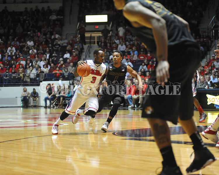 Ole Miss' Derrick Millinghaus (3) vs. Missouri's Phil Pressey (1) at the C.M. &quot;Tad&quot; Smith Coliseum on Saturday, January 12, 2013. Ole Miss defeated #10 ranked Missouri 64-49.