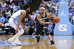 28 December 2016: Monmouth's Justin Robinson (12) and North Carolina's Joel Berry II (left). The University of North Carolina Tar Heels hosted the Monmouth University Hawks at the Dean E. Smith Center in Chapel Hill, North Carolina in a 2016-17 NCAA Division I Men's Basketball game. UNC won the game 102-74.