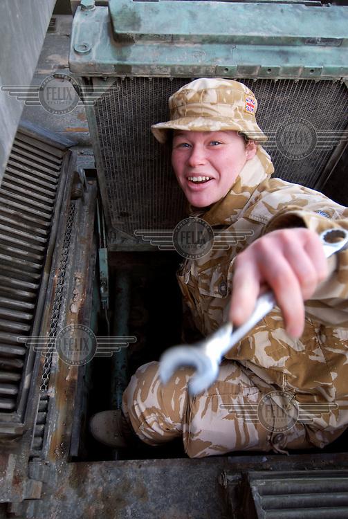 Vehicle mechanic Corporal Girvan working inside the British Base....