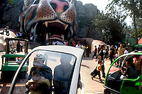 Visitors gather around the entrance to the lion and tiger house at the Tianjin Zoo in Tianjin, China.