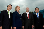 United States Secretary of State Hillary Rodham Clinton, second from left, South Korean Foreign Minister Yu Myung-hwan, left, U.S. Secretary of Defense Robert Gates, second from right, and South Korean Defense Minister Kim Tae-young pose for the media at the truce village of Panmunjom in the demilitarized zone (DMZ) that separates the two Koreas since the Korean War, north of Seoul, South Korea, Wednesday, July 21, 2010. .Mandatory Credit: Cherie Cullen - DoD via CNP