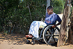 Caroline Mandishona moves carefully through a gate in the fence around her home in Bulawayo, Zimbabwe. Mandishona suffered cerebral palsy and uses a wheelchair provided by the Jairos Jiri Association with support from CBM-US.
