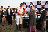 Her Highness Rajmata Padmini Devi of Jaipur presents a trophy to a polo player of the Royal Jaipur Polo Team after they win a close match for the Argyle Pink Diamond Cup, organised as part of the 2013 Oz Fest in the Rajasthan Polo Club grounds in Jaipur, Rajasthan, India on 10th January 2013. Photo by Suzanne Lee