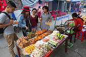 Hmong tribe teens shopping at Muong Hum market, Vietnam.